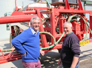 Alastair Jeffrey checks the sprayer with  Peter Blatchley