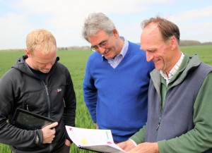 Rob Baker (right) and Craig Livingstone study the latest MAP report with Alastair Jeffrey